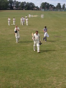 John Garnham returns to the pavilion at the Boys School after his 125 not out