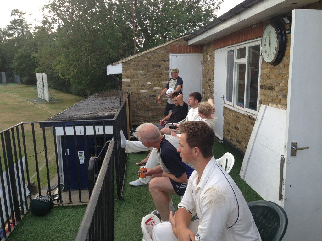 Tim Stevens awaits his turn to bat on the Watford balcony