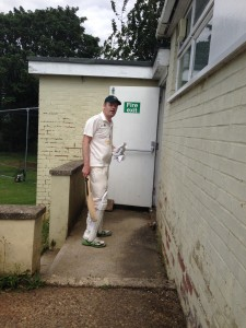 Chris Cole returns to the Hitchin pavilion after his 111