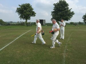 Greig Hearne (100*) and Paul Constantinidi (58*) return to the pavilion at Whitwell after their unbeaten partnership of 179 against Flamstead 2nds